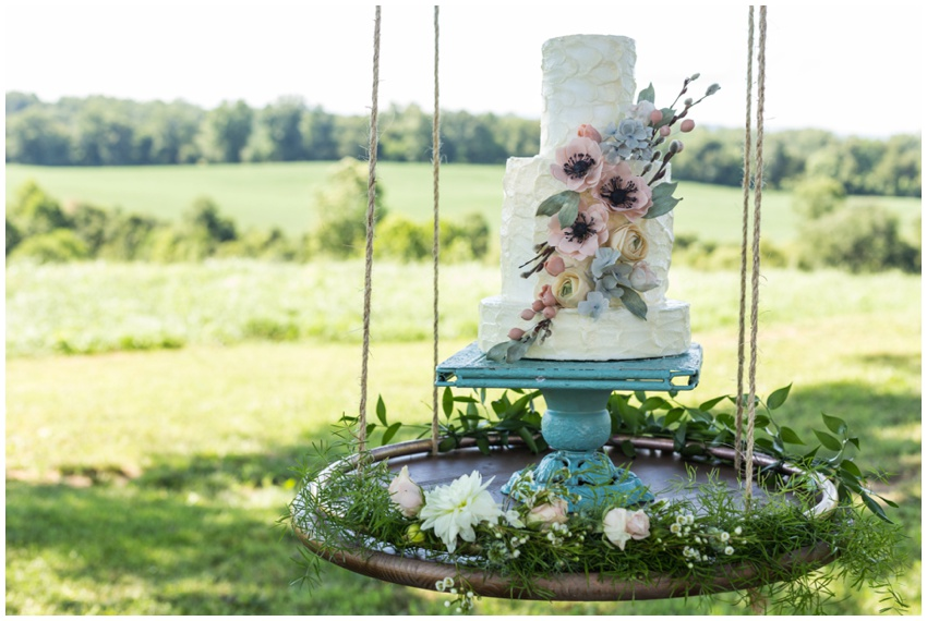 wedding cake on a swing, with a side of pink skies and flowing ...
